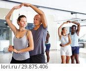 Купить «Couples enjoying dances in studio», фото № 29875406, снято 30 июля 2018 г. (c) Яков Филимонов / Фотобанк Лори