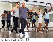 Купить «People practicing dance movements in class», фото № 29875418, снято 30 июля 2018 г. (c) Яков Филимонов / Фотобанк Лори