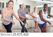 Купить «People dancing lindy hop during group training», фото № 29875426, снято 30 июля 2018 г. (c) Яков Филимонов / Фотобанк Лори