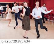 Купить «Couples enjoying active dance», фото № 29875634, снято 24 мая 2017 г. (c) Яков Филимонов / Фотобанк Лори