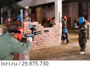 Купить «Players are targeting in opponents from cover in battlefield.», фото № 29875730, снято 10 июля 2017 г. (c) Яков Филимонов / Фотобанк Лори