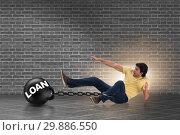 Купить «Student in loan and expensive education concept», фото № 29886550, снято 19 марта 2019 г. (c) Elnur / Фотобанк Лори