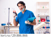 Young male doctor in blood transfusion concept. Стоковое фото, фотограф Elnur / Фотобанк Лори