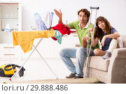Купить «Husband helping leg injured wife in housework», фото № 29888486, снято 4 октября 2018 г. (c) Elnur / Фотобанк Лори
