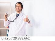 Купить «Young doctor in front of whiteboard», фото № 29888662, снято 10 октября 2018 г. (c) Elnur / Фотобанк Лори