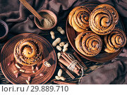 Купить «Cinnamon rolls buns with peanuts on a plate», фото № 29889710, снято 29 января 2019 г. (c) Oksana Zh / Фотобанк Лори