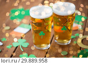 Купить «glasses of beer and st patricks day party props», фото № 29889958, снято 31 января 2018 г. (c) Syda Productions / Фотобанк Лори