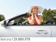 Купить «happy young woman in convertible car», фото № 29889978, снято 17 августа 2017 г. (c) Syda Productions / Фотобанк Лори