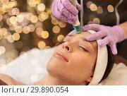 Купить «woman having microdermabrasion facial treatment», фото № 29890054, снято 26 января 2017 г. (c) Syda Productions / Фотобанк Лори