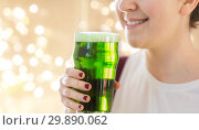 Купить «close up of woman with green beer in glass», фото № 29890062, снято 31 января 2018 г. (c) Syda Productions / Фотобанк Лори