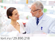 Купить «apothecary and woman with drug at pharmacy», фото № 29890218, снято 27 июня 2015 г. (c) Syda Productions / Фотобанк Лори