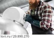 Купить «brewer working at craft brewery or beer plant», фото № 29890270, снято 24 марта 2017 г. (c) Syda Productions / Фотобанк Лори