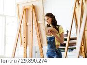 Купить «student girl with easel painting at art school», фото № 29890274, снято 26 мая 2017 г. (c) Syda Productions / Фотобанк Лори