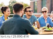 Купить «friends having dinner or bbq party on rooftop», фото № 29890414, снято 2 сентября 2018 г. (c) Syda Productions / Фотобанк Лори