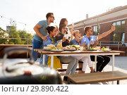 Купить «happy friends taking selfie at rooftop party», фото № 29890422, снято 2 сентября 2018 г. (c) Syda Productions / Фотобанк Лори