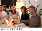 happy family having tea party at home. Стоковое фото, фотограф Syda Productions / Фотобанк Лори