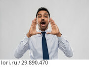 Купить «indian businessman shouting or calling over grey», фото № 29890470, снято 12 января 2019 г. (c) Syda Productions / Фотобанк Лори