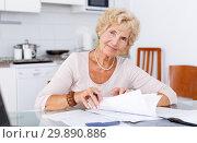Купить «Woman put in order documents», фото № 29890886, снято 11 июля 2018 г. (c) Яков Филимонов / Фотобанк Лори