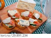 Купить «Canape with soft cheese at fresh bread with cucumber and salmon», фото № 29891234, снято 23 марта 2019 г. (c) Яков Филимонов / Фотобанк Лори