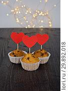 Купить «Three tasty cupcakes with big red hearts», фото № 29892018, снято 5 февраля 2019 г. (c) Kira_Yan / Фотобанк Лори