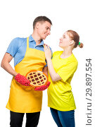 Купить «portrait of a man in an apron with a pie and her beloved wife on white background isolated», фото № 29897554, снято 14 октября 2018 г. (c) Константин Лабунский / Фотобанк Лори