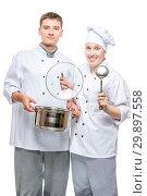 Купить «professional chefs with a pan and a ladle on a white background posing», фото № 29897558, снято 14 октября 2018 г. (c) Константин Лабунский / Фотобанк Лори