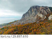 Купить «Autumn landscape, beautiful mountains, yellow plants and a calm sea», фото № 29897610, снято 9 ноября 2017 г. (c) Константин Лабунский / Фотобанк Лори
