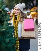 Купить «Woman buying Christmas tree», фото № 29898502, снято 20 декабря 2018 г. (c) Яков Филимонов / Фотобанк Лори