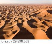 Купить «Aerial view on dunes in Sahara desert», фото № 29898558, снято 14 февраля 2018 г. (c) Михаил Коханчиков / Фотобанк Лори