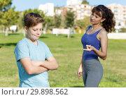 Купить «Mother berating son outdoors», фото № 29898562, снято 11 ноября 2018 г. (c) Яков Филимонов / Фотобанк Лори