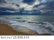 stormy sky over sea and sandy beach. Стоковое фото, фотограф Михаил Коханчиков / Фотобанк Лори