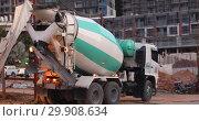 Купить «Concrete mixer truck construction site work», видеоролик № 29908634, снято 7 февраля 2019 г. (c) Ekaterina Demidova / Фотобанк Лори