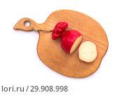 Купить «Твёрдый копчёный сыр ручной работы в парафиновой оболочке», фото № 29908998, снято 13 января 2019 г. (c) V.Ivantsov / Фотобанк Лори