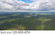 Купить «Aerial landscape with river in Ural mountains», видеоролик № 29909474, снято 29 декабря 2018 г. (c) Михаил Коханчиков / Фотобанк Лори