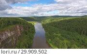 Купить «Aerial of cave in rock on Yuryuzan river in Russia», видеоролик № 29909502, снято 30 декабря 2018 г. (c) Михаил Коханчиков / Фотобанк Лори