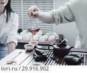 Купить «Chinese puerh tea ceremony», фото № 29916902, снято 19 января 2019 г. (c) Ольга Сергеева / Фотобанк Лори