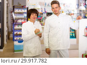 Купить «Pharmacist and pharmacy technician posing in drugstore», фото № 29917782, снято 21 октября 2016 г. (c) Яков Филимонов / Фотобанк Лори