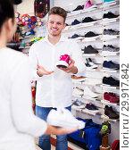 Купить «Male shop assistant helping customer», фото № 29917842, снято 22 ноября 2016 г. (c) Яков Филимонов / Фотобанк Лори