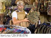 Купить «Male customer try on ammunition with rifle», фото № 29918074, снято 4 июля 2017 г. (c) Яков Филимонов / Фотобанк Лори