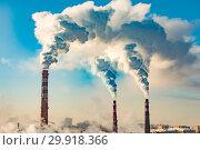 Купить «Производственные заводские трубы на фоне синего неба . Концепция загрязнения окружающей среды .», фото № 29918366, снято 18 июня 2019 г. (c) Сергеев Валерий / Фотобанк Лори
