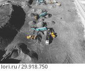 Купить «View from above, on the process of sorting coal mined. Open pit mine, Mining coal extractive industry anthracite.», фото № 29918750, снято 26 сентября 2018 г. (c) Сергей Тимофеев / Фотобанк Лори
