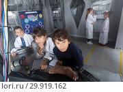 Купить «Children playing in bunker questroom», фото № 29919162, снято 21 октября 2017 г. (c) Яков Филимонов / Фотобанк Лори