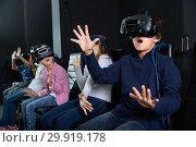 Купить «Enthusiastic children in virtual reality glasses in quest room», фото № 29919178, снято 21 октября 2017 г. (c) Яков Филимонов / Фотобанк Лори