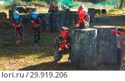 Купить «Group of cheerful kids playing paintball», фото № 29919206, снято 24 ноября 2018 г. (c) Яков Филимонов / Фотобанк Лори