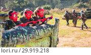 Купить «Opposing teams of happy kids shooting paintball», фото № 29919218, снято 24 ноября 2018 г. (c) Яков Филимонов / Фотобанк Лори