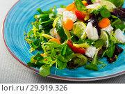Купить «Tasty salad of hake, lemon, lettuce leaves and fresh carrots», фото № 29919326, снято 26 марта 2019 г. (c) Яков Филимонов / Фотобанк Лори