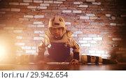 Купить «Little girl training her karate skills. Showing a horizontal split», видеоролик № 29942654, снято 8 июля 2020 г. (c) Константин Шишкин / Фотобанк Лори