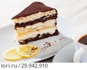 Купить «Delicious layer lemon сhocolate сake сloseup», фото № 29942910, снято 18 марта 2019 г. (c) Яков Филимонов / Фотобанк Лори