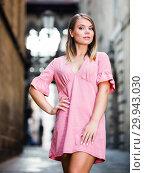 Купить «Young woman standing at the street among architecture in Barcelona», фото № 29943030, снято 26 июня 2019 г. (c) Яков Филимонов / Фотобанк Лори