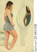 Купить «Young sexy woman in pygama using mirror in bedroom», фото № 29943038, снято 5 марта 2018 г. (c) Яков Филимонов / Фотобанк Лори